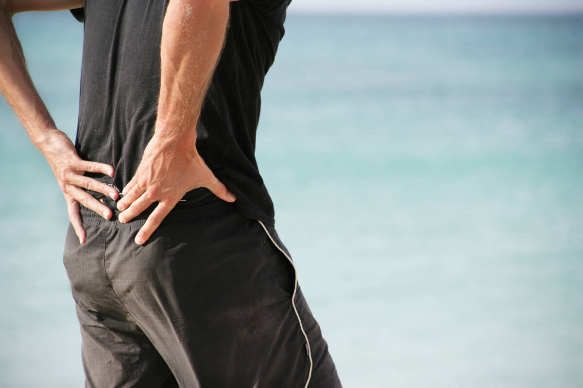 Image of person experiencing sciatica back pain